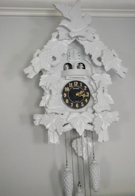 large modern white cuckoo clock