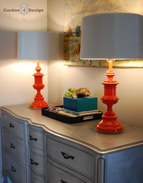 tangerine lamps on silver dresser