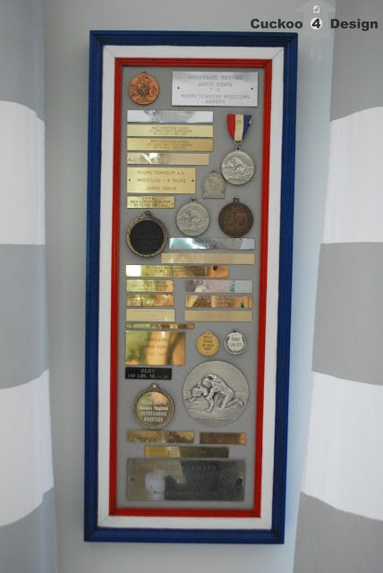 repurposing old medals and plaques in a collage