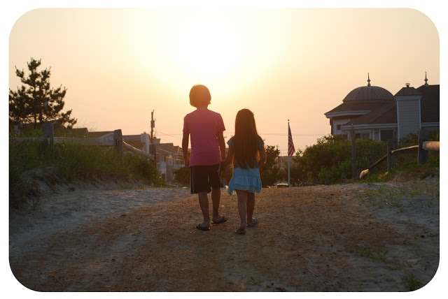 kids walking into the sunset