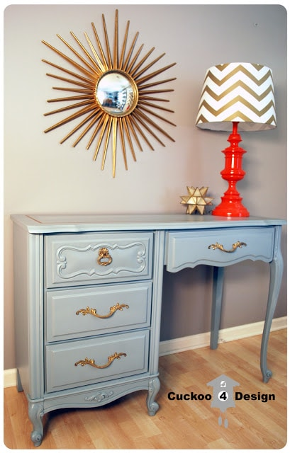 grey french provincial dresser with gold accents