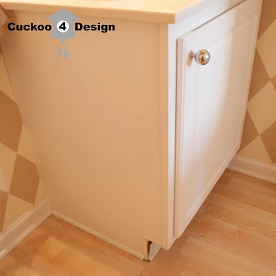 white vanity with ugly kick plate