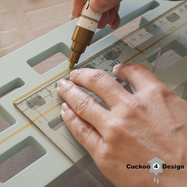 painting lines on mint mirror by cuckoo4design