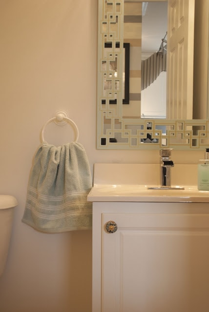 mint and gold color combo in bathroom