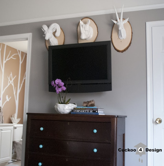 tree branch decal and white animal heads