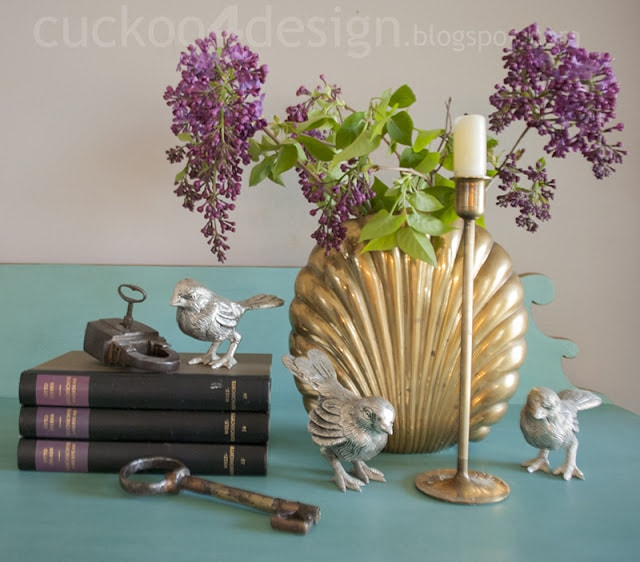 brass accents with books and silver
