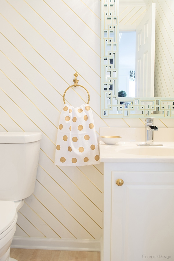 gold and white powder room