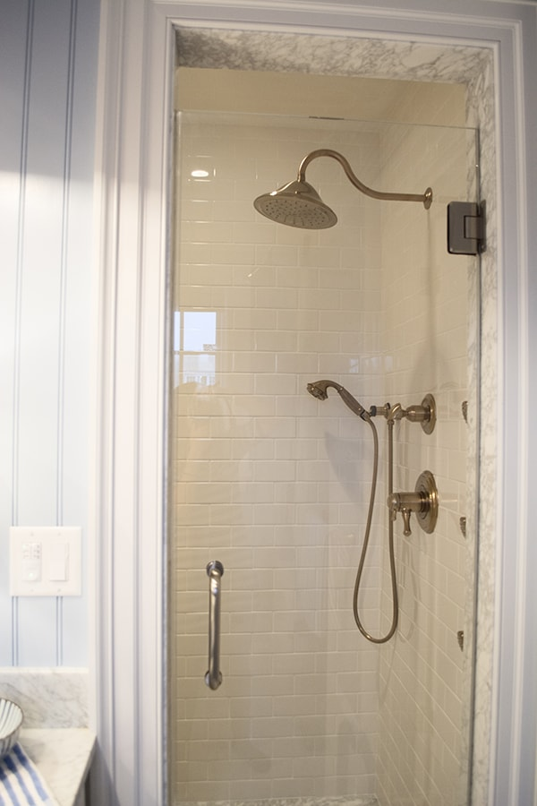 shower with @deltafaucet fixtures in the 2015 HGTV dream home on Martha's Vineyard - Cuckoo4Design