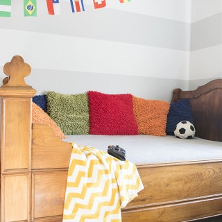 boys room with world cup flag banner and grey horizontal striped walls