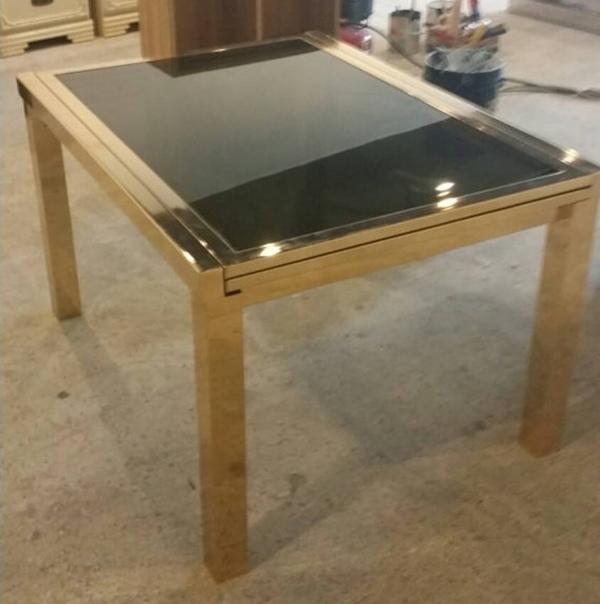 Superb Milo Baughman extendable brass dining table