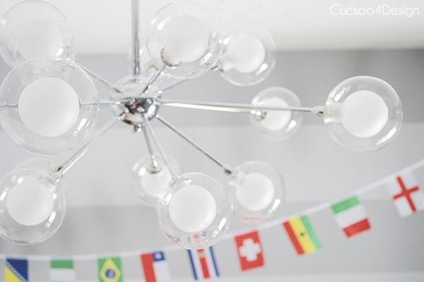 boys room with silver sputnik fixture