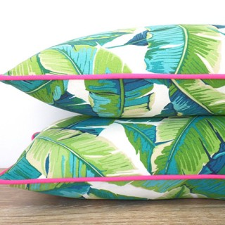 tropical pillows with pink neon piping