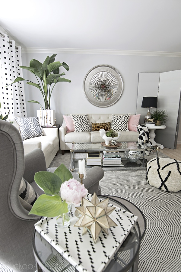 neutral eclectic summer living room with hints of pink