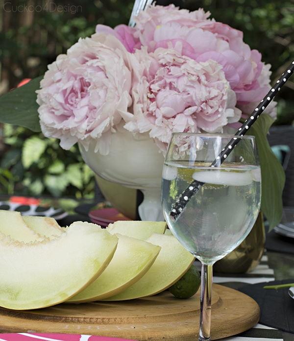 light pink peonies on patio table setting