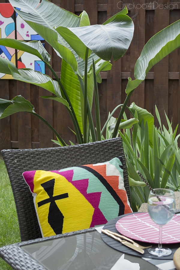 colorful aztec pillows and abstract art on patio