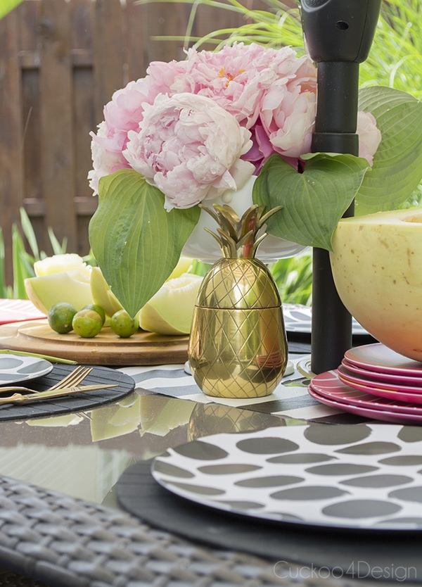 brass pineapple on outdoor dining table