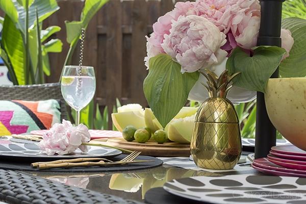 Marimekko plates on patio table setting with brass pineapple