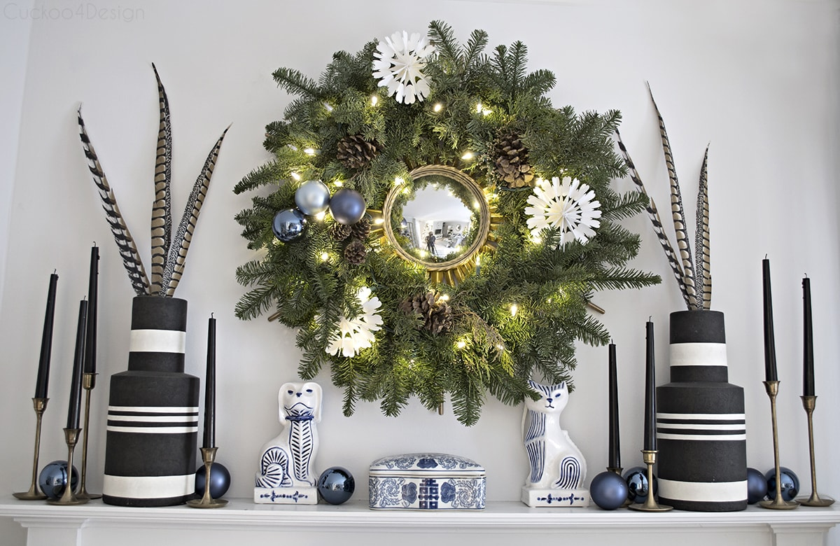 Christmas wreath over fireplace with paper snowflakes and blue accents