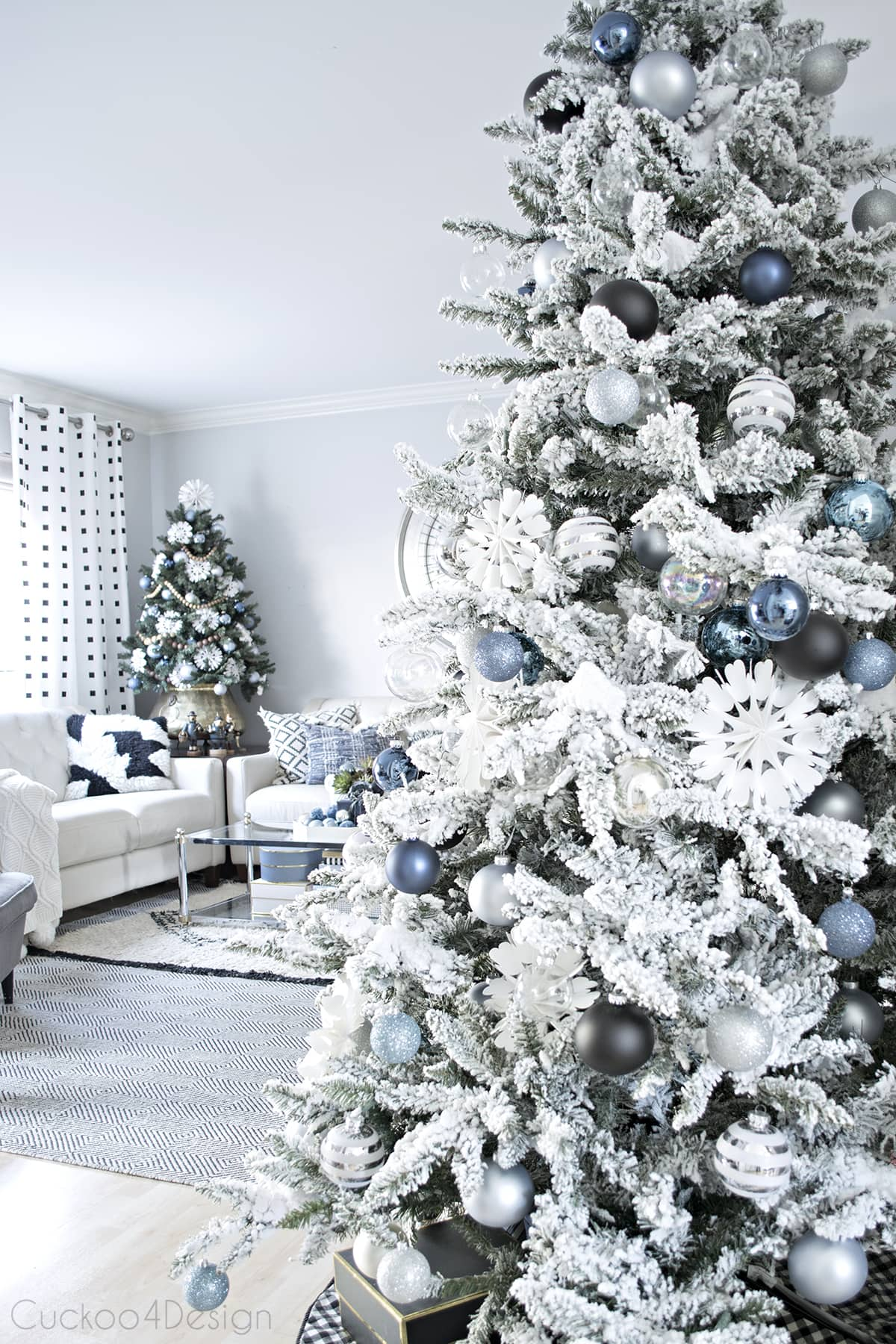 silver, blue, black and white Christmas tree with DIY paper snowflakes
