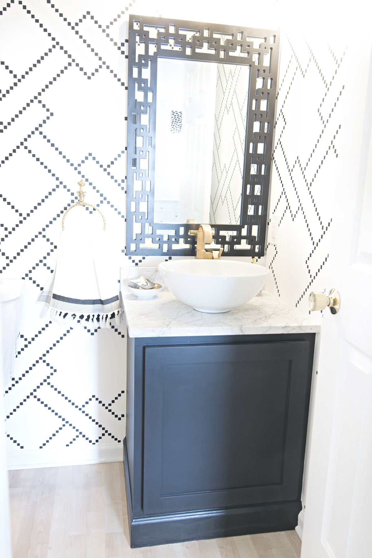 black and white geometric powder room