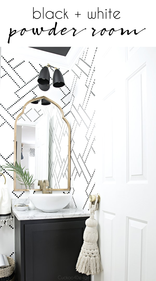 black and white powder room with gold accents and an eclectic  global vibe