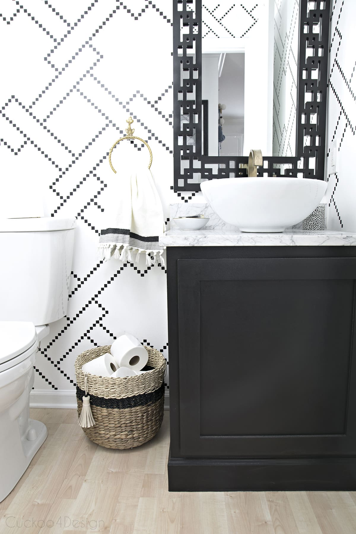 custom black and gold vanity light in black and white powder room
