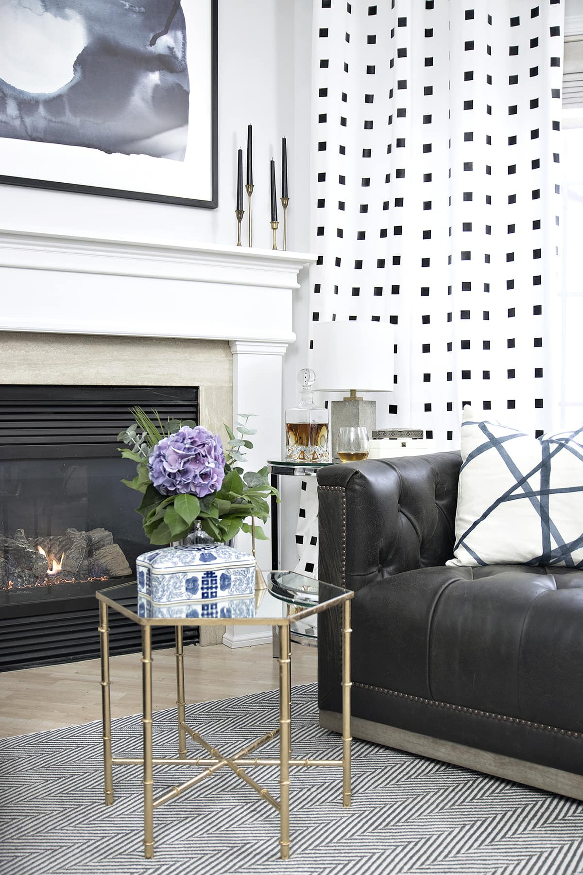Classic eclectic living room fireplace area makeover with @raymourflanigan including leather swivel chairs, mixed metal accent furniture, concrete lamps and hints of blue.