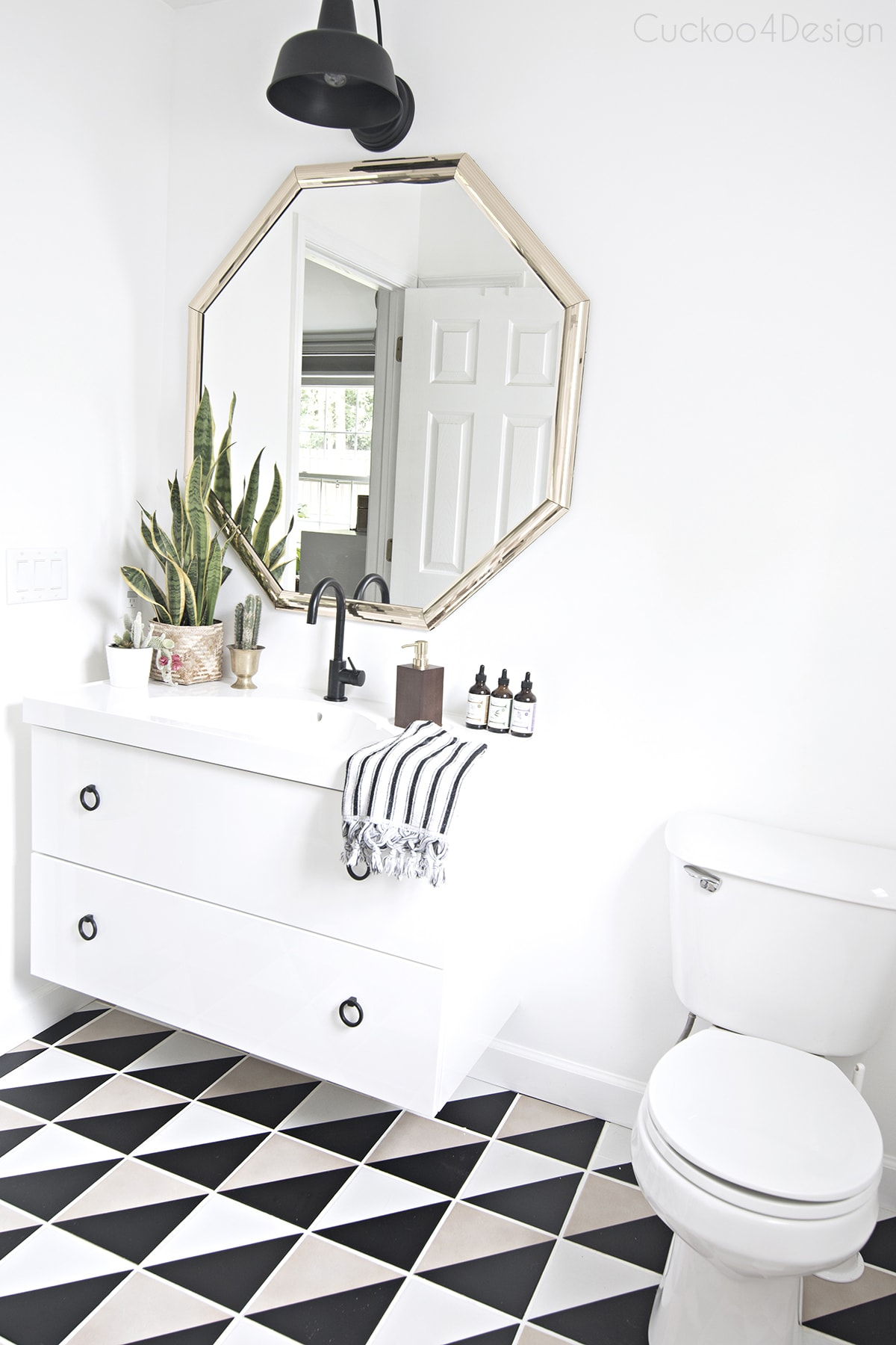 black and white budget bathroom makeover with easy tile update