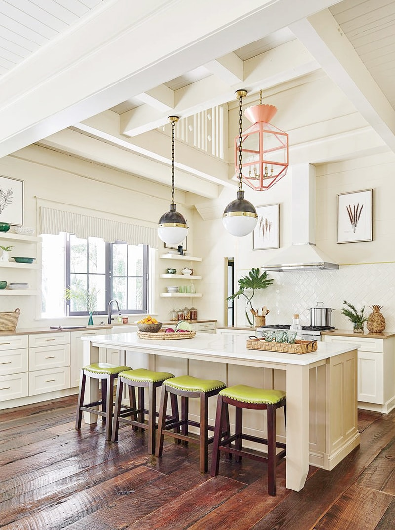 beautiful southern coastal kitchen in cream, green and white with dark wood accents and mixed metals, coral colored chandelier and hicks pendants