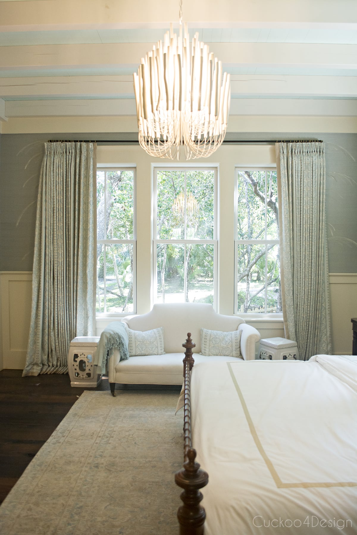 tranquil and serene master bedroom in dark mint green tones with vintage bamboobed and Arteriors Tilda chandelier