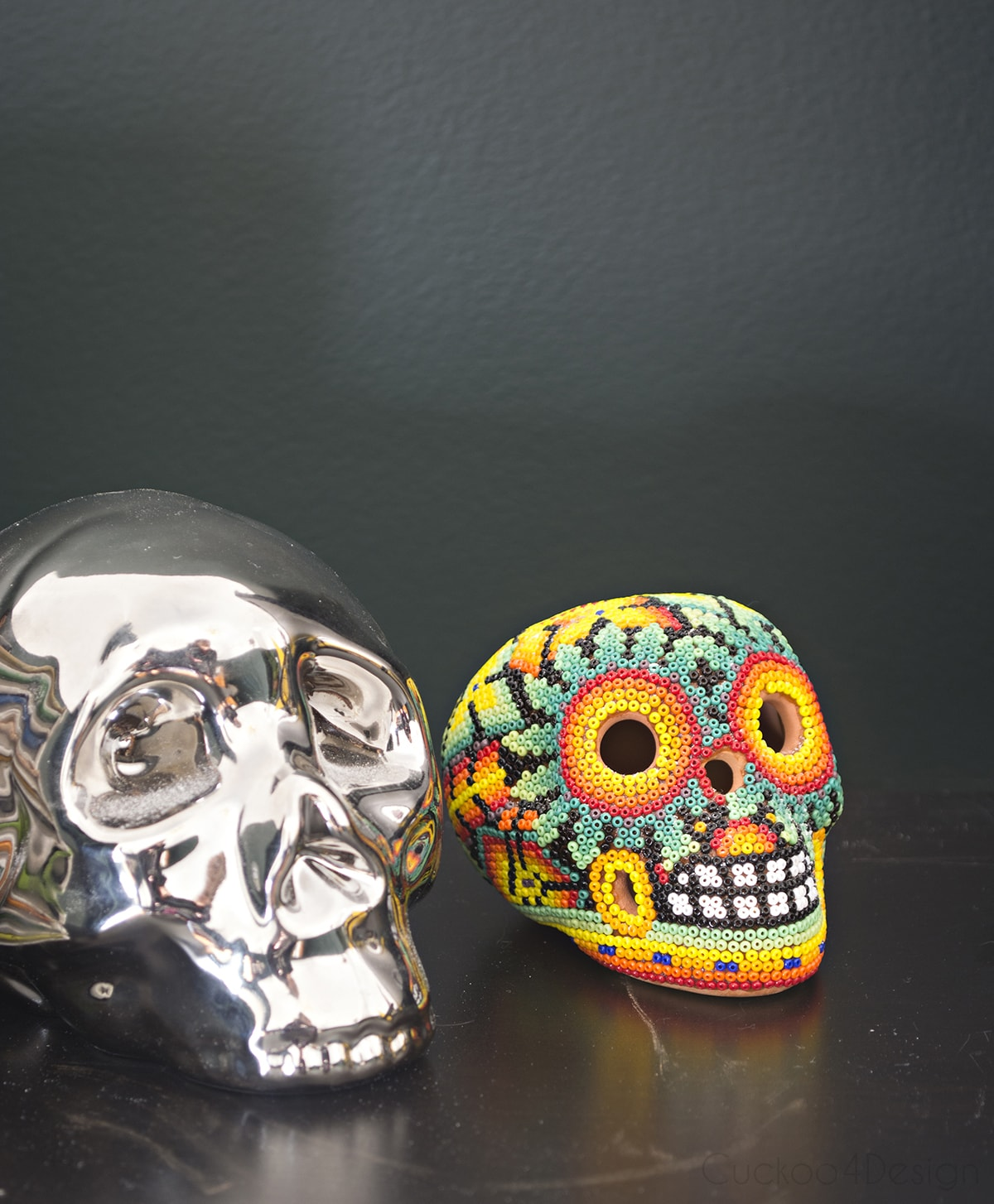 dark green walls with skull collection