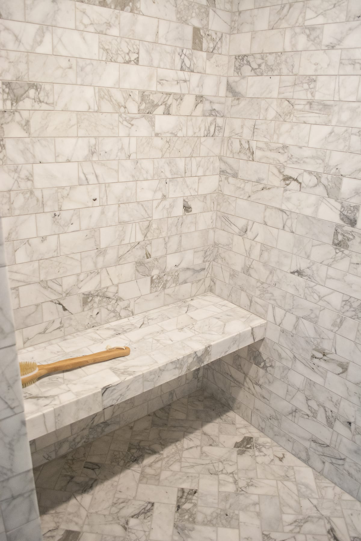marble bathroom with Delta fixtures