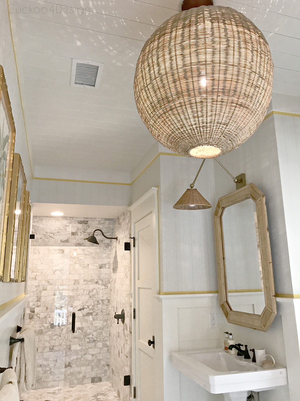 marble master bathroom and hicker rattan accents