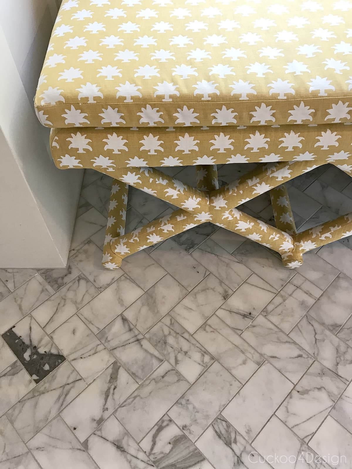 x-bench upholstered with Mally Skok Flora Too Custurd fabric in marble master bathroom