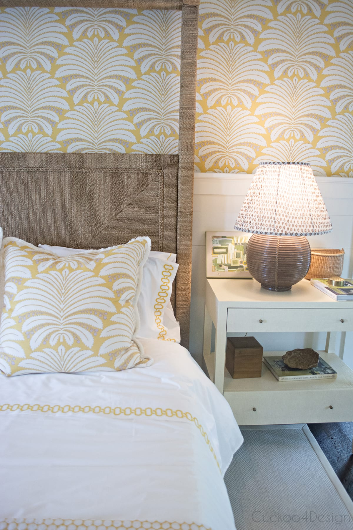 vintage whicker rattan canopy bed in master bedroom with Hines Palmyra in yellow wallpaper and fabric