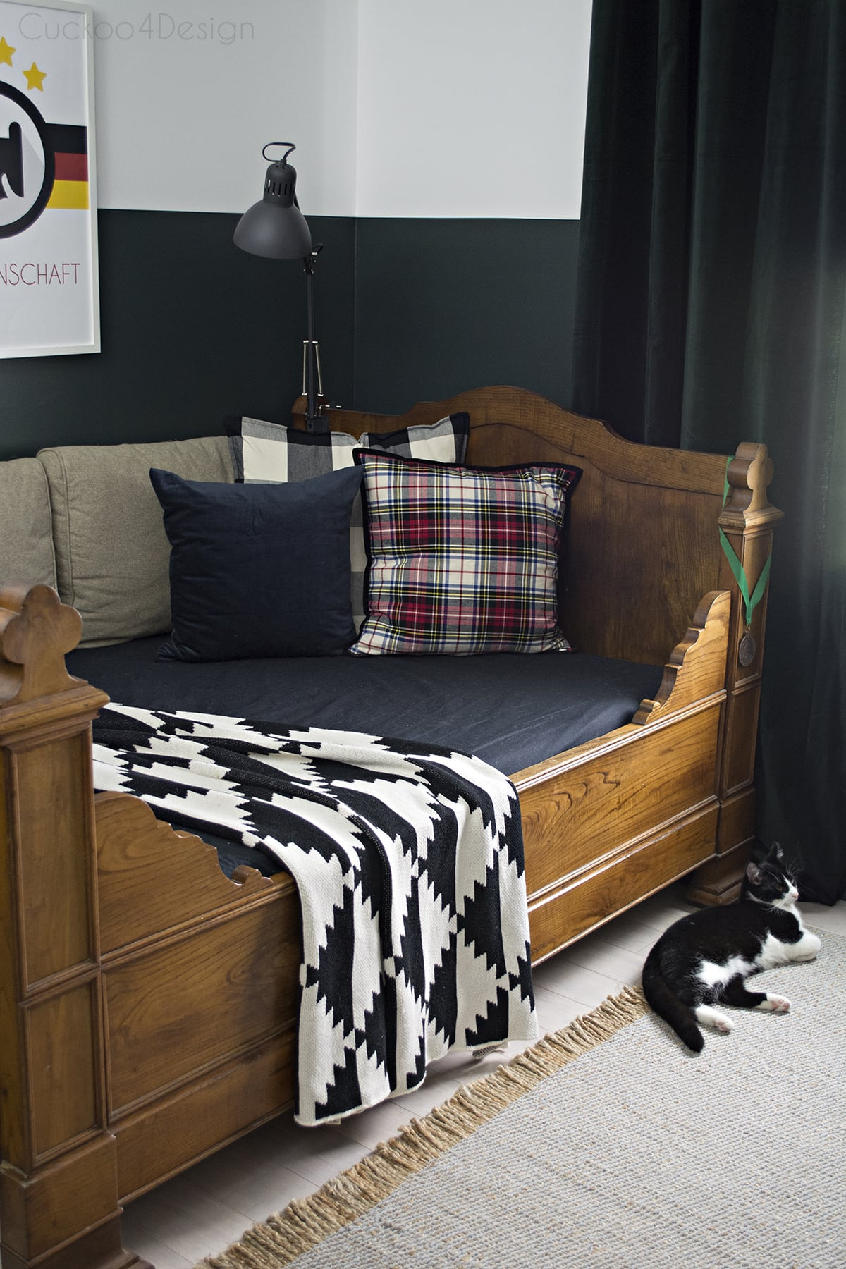 butterscotch leather butterfly chair in sophisticated boys bedroom with dark green walls, mixed plaids and soccer memorabilia