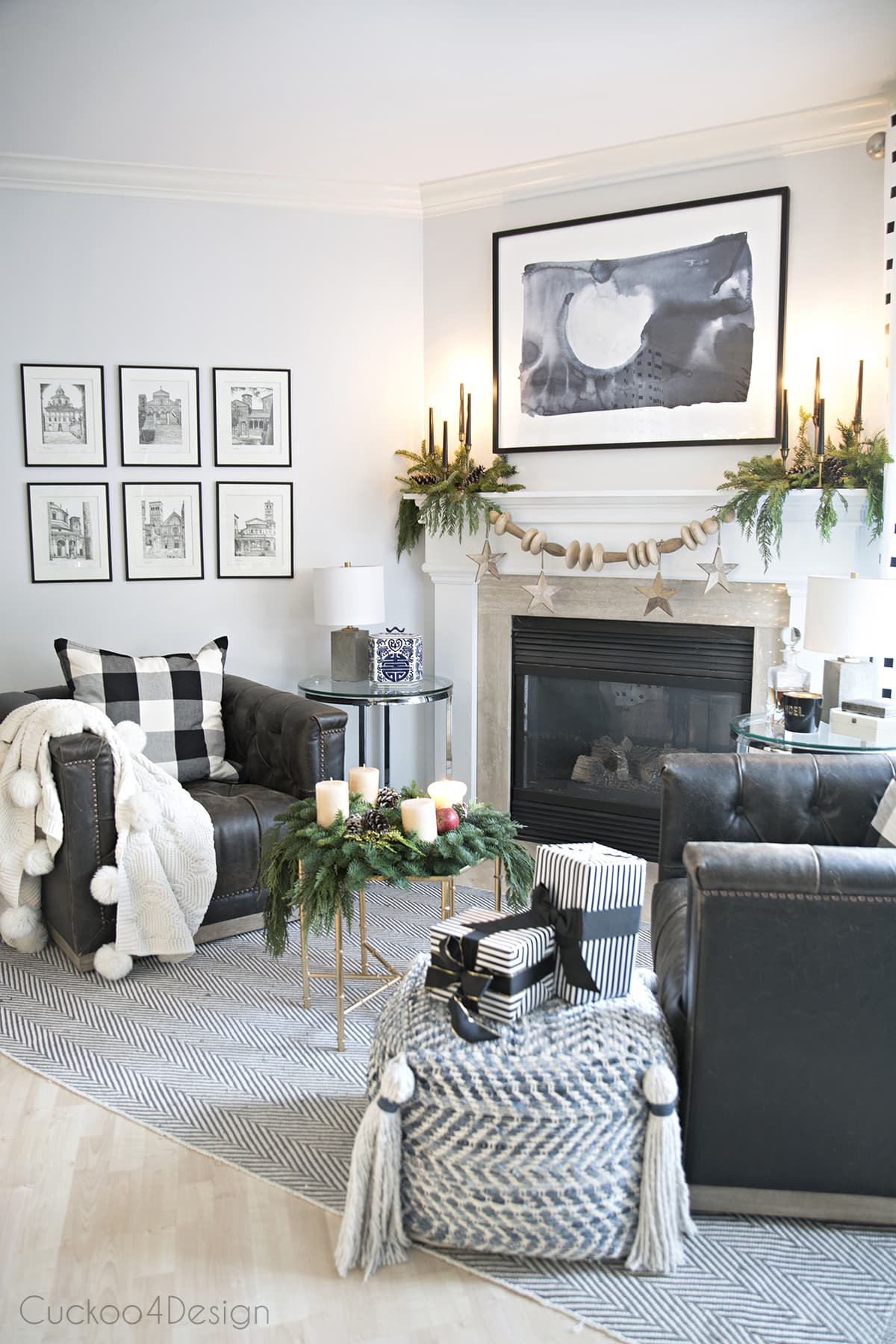 blue, black and white fireplace area with leather swivel chair and natural Christmas decor