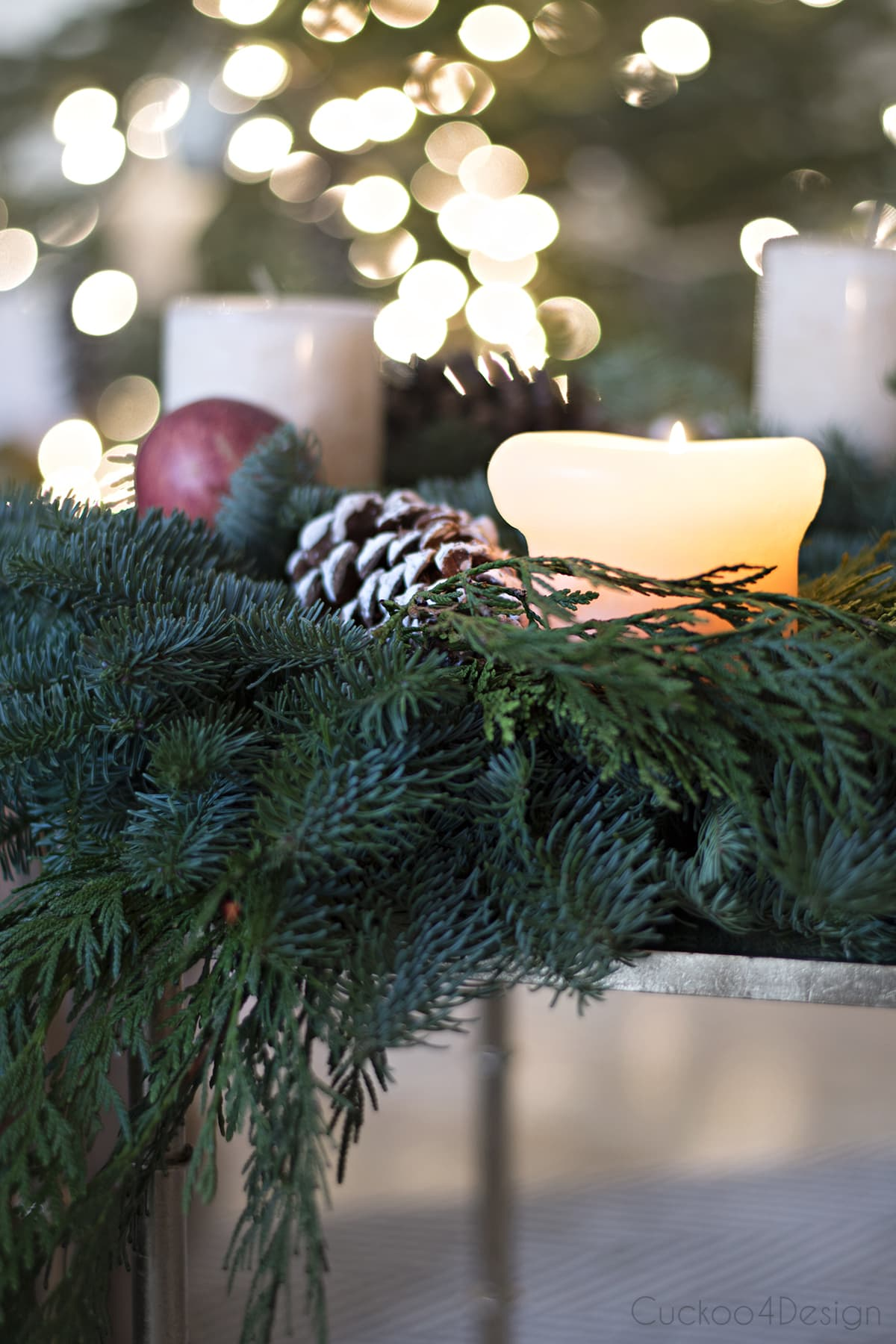 natural advent Christmas wreath in front of Christmas tree