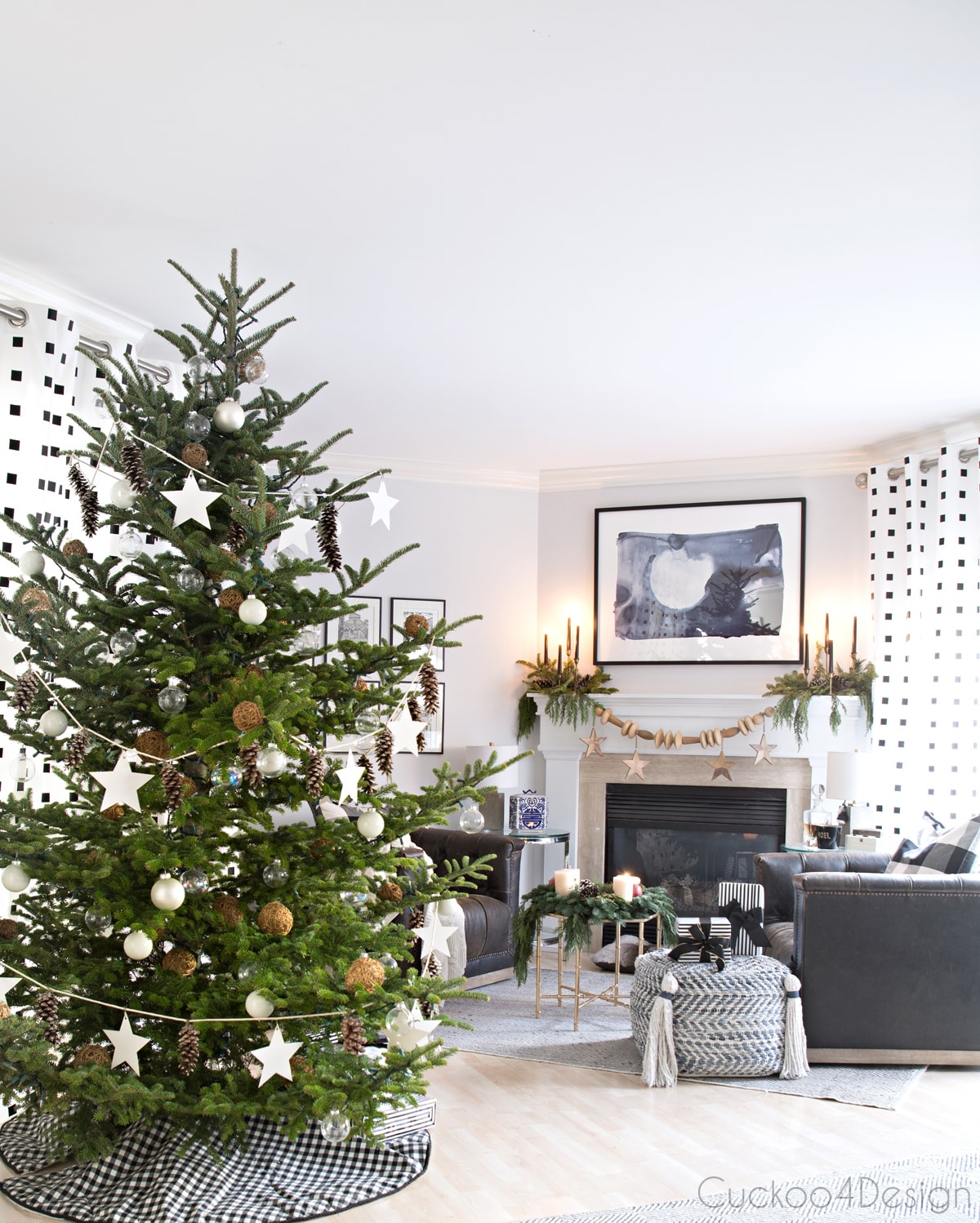 Modern European Eclectic Christmas Tree with pinecones, white stars, clear Christmas balls and white Christmas balls on a real untrimmed fir tree